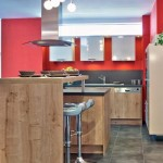 Kitchen with red accent wall